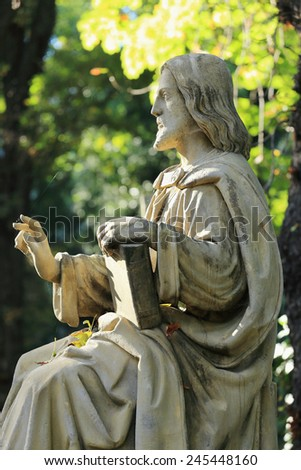 Historic Jesus on the mystery autumn old Prague Cemetery, Czech Republic - stock photo