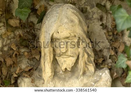Historic Jesus on the mystery autumn old Prague Cemetery, Czech Republic - stock photo