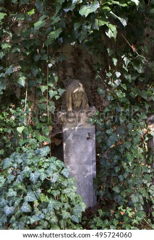Historic Jesus on the mystery old Prague Cemetery, Czech Republic