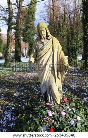 Historic Jesus on winter old Prague Cemetery, Czech Republic - stock photo