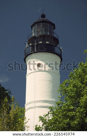historic Key West Lighthouse at a sunny day against clear blue sky in vintage style, Key West, Florida Keys, USA - stock photo