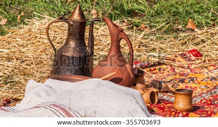 historic medieval earthenware or metal pitcher on holiday