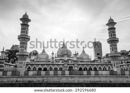 Historic mosque, Masjid Jamek at Kuala Lumpur, Malaysia at sunset - stock photo