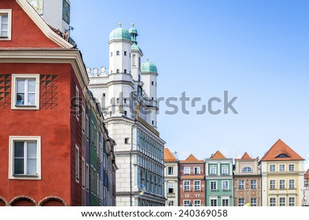 Historic Poznan City Hall and colorful buildings - stock photo