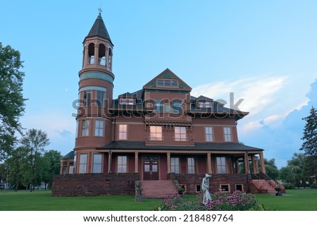 Historic Queen Anne style Victorian mansion and grounds in Superior Wisconsin - stock photo