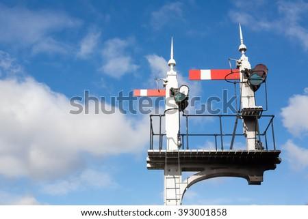 Historic red home British railway signals - stock photo