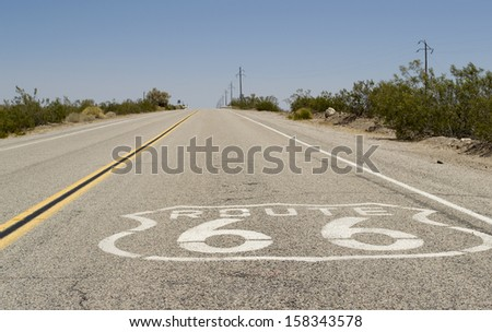 Historic Route 66 crossing the Mojave Desert in California - stock photo