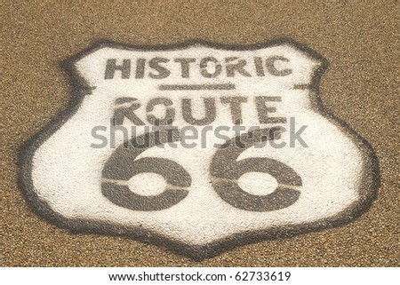 Historic Route 66 sign painted on the roadway - stock photo