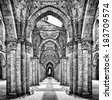 Historic ruins of abandoned abbey in black and white - stock photo