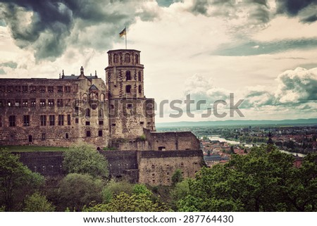 Historic Ruins of Heidelberg Castle with Waving Flag Overlooking Picturesque Town and Neckar River Below, Baden-Wurttemberg, Germany