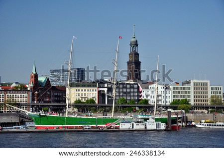historic sailing ship in Hamburg harbour and michel church in background, Germany, Europe