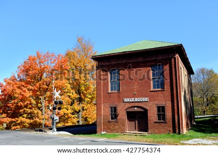 Historic Salt House sits besides railroad tracks in the old town of Jonesborough, Tennessee.  Autumn colors the trees around the Salt House. - stock photo