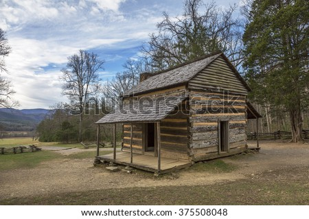 Historic Smoky Mountains Cabin in Smoky Mountains National Park in Autumn - Cades Cove, Tennessee - stock photo