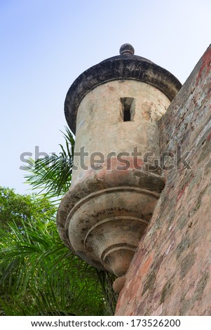 Historic Spanish lookout tower on tall fortress walls in San Juan, Puerto Rico - stock photo