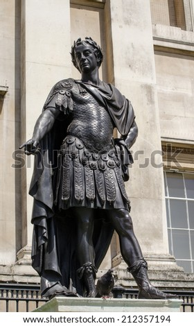 Historic statue of King James II of England,  also King James VII of Scotland.  The sculpture, in Trafalgar Square was created by Grinling Gibbons and has been on public display in London since 1686. - stock photo