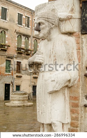 Historic stone statue of a Moorish trader, believed to be a member of the Levantine Mastelli family, with a repair to his nose.  Castello, Venice. - stock photo