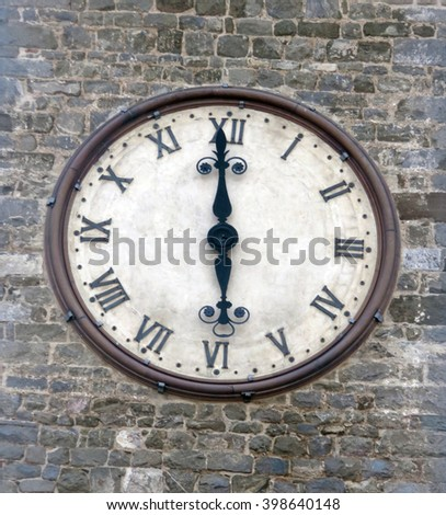 Historic town clock in Montalcino, Italy - the tall and slender clock tower that graces the Palazzo dei Priori, the city's town hall, is a landmark. - stock photo