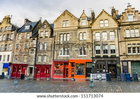 Historic Town Houses and Colourful Shopfronts in Edinburgh Old Town - stock photo