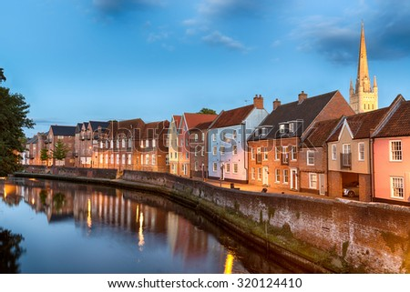 Historic town houses at night on Quay Side in Norwich, Norfolk - stock photo