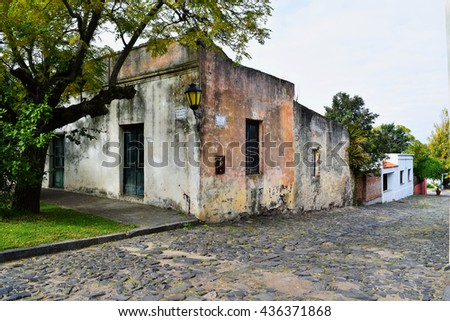 Historic traditional houses and cobblestone street in old town of Colonia Del Sacramento, Uruguay.  - stock photo