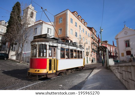 Historic tram nr 28 on the street of Alfama district in the city of Lisbon in Portugal. - stock photo