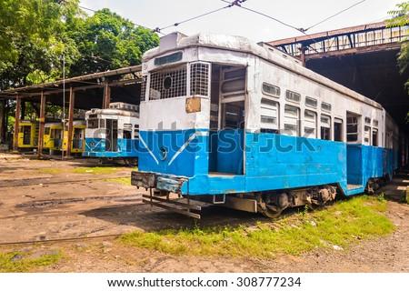 Historic trams of Kolkata standing at a depot waiting for departure - stock photo