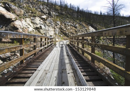 Historic Trestle Bridge. Myra Canyon in British Columbia, Myra Canyon is a popular tourist attraction featuring a cycling and hiking trail following the historical route of the Kettle Valley Railway.  - stock photo