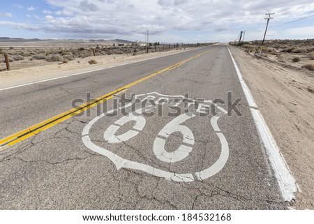 Historic US Route 66 through California's arid Mojave desert.   - stock photo