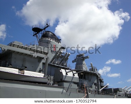 Historic USS Missouri Guns, radar, and satellite towers at midship docked in Pearl Harbor on Oahu, Hawaii. - stock photo
