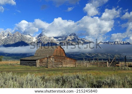 Historic wooden barn in the Teton's, Wyoming, USA. - stock photo