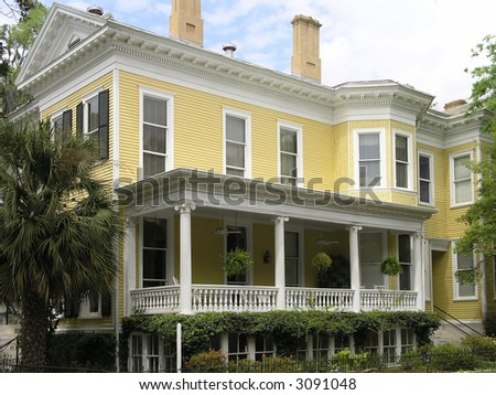 Historic yellow house with windows and porch