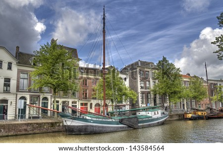 Historical boat in a canal in Schiedam, Holland - stock photo