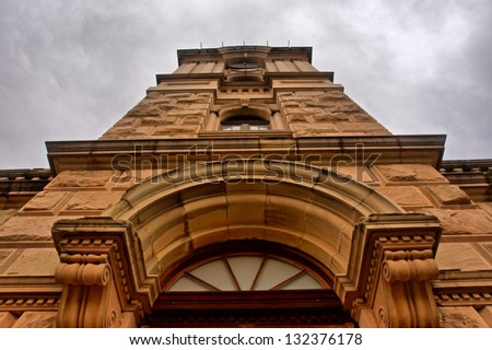 Historical building - dramatic angle view. Shot in Oudtshoorn, Western Cape, South Africa. - stock photo