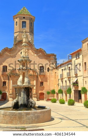 Historical buildings and beautiful fountain of the Monastery of Santa Maria de Santes Creus in Catalonia, Spain - stock photo