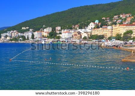 Historical buildings and distant beaches on the Adriatic sea shore, Opatija, Croatia - stock photo