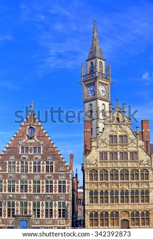 Historical buildings and the tall clock tower of the Old Post Office, Ghent, Belgium