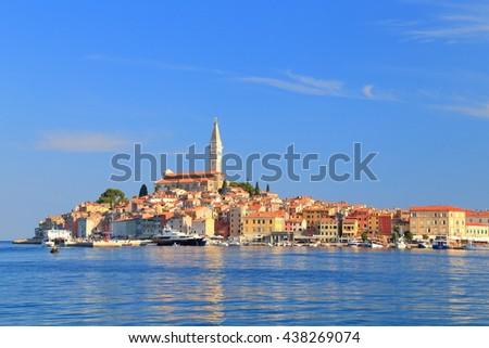 Historical buildings and Venetian church in Rovinj, Croatia - stock photo