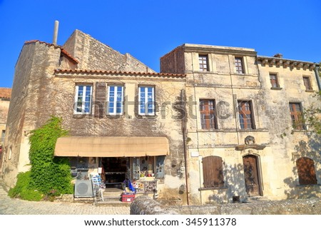 Historical buildings on sunny street of Les Baux de Provence, Provence, France - stock photo