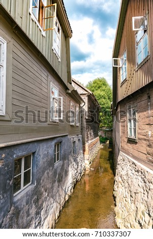 Historical centre of Kuldiga city, Latvia, Europe. Small river canal going trough the city centre.