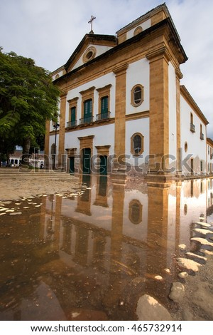 Historical church in Paraty and its reflection on the water flooded