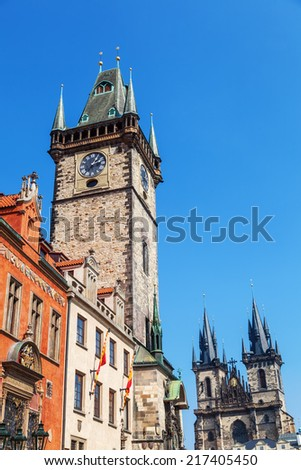 historical City Hall Tower with the famous astronomical clock and Church of Our Lady before Tyn at the Old Town Square in Prague, Czechia  - stock photo