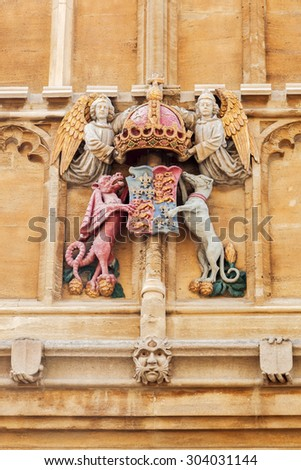historical crest on a building wall in Oxford, England - stock photo