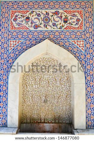 Historical fountain covered handmade Turkish -Ottoman tiles - Kutahya, Turkey - stock photo