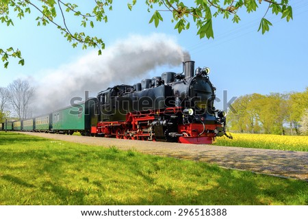 Historical German steam train in spring, Rugen, Germany - stock photo