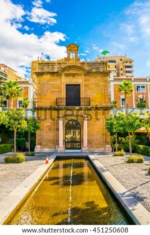 historical house situated inside of the port of malaga in spain - stock photo