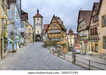 Historical houses and towers in the old city of Rothenburg ob der Tauber, Germany - stock photo