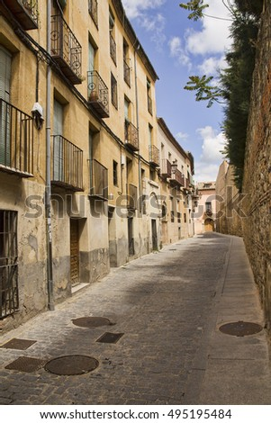 Historical houses in a quiet street in the old part of Segovia, Spain