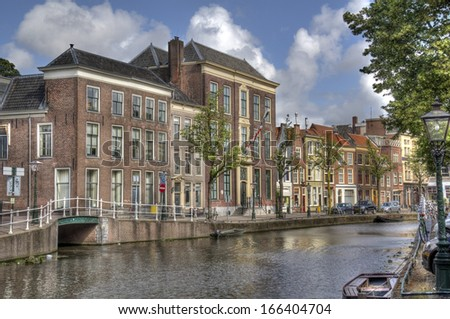 Historical houses on a canal in Leiden, Holland - stock photo