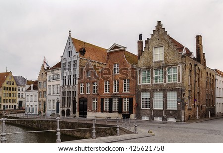 historical houses on Canal embankment in Bruges, Belgium - stock photo