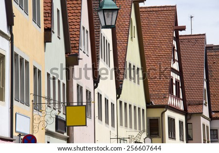 Historical houses with red tiled roofs in the old city of Rothenburg ob der Tauber, Germany - stock photo